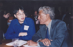 Joe Brown '66 chats with Albert Wu '05, one of the recipients of the Eric V. Smith scholarships.
