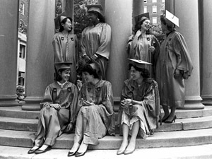 Members of the Class of 1987 gathered at the Van Amringe Memorial: (standing, left to right) Kokoro Kawashima, Vania Leveille, Marya Pollack and Shelley Coleman; (seated, left to right) Ilaria Rebay, the salutatorian, Linda Mischel, the valedictorian, and Hannah Jones, class president.