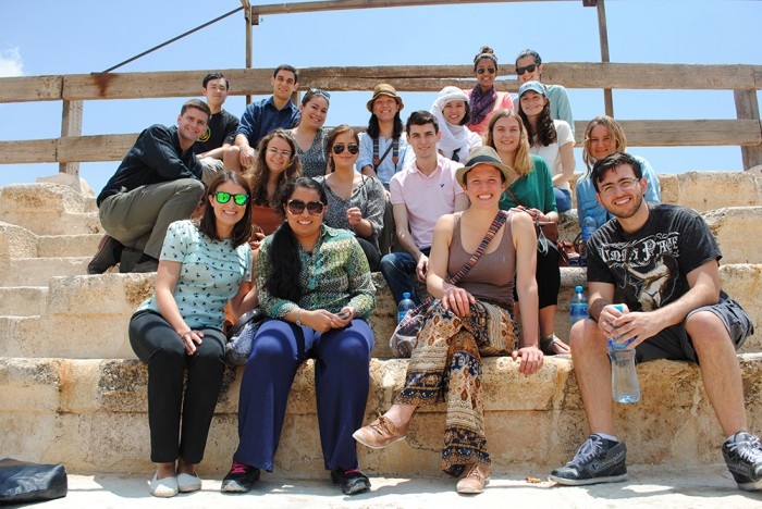 The CEO Amman group poses for a photo at Jerash, in the north of Jordan. Front Row: Jennie Preis, Doreen Mohammad CC'15, Alex Swift CC'15, Jamil Muna CC'15; 2nd Row: Brina Seidel CC'15, Lilia Cherchari CC'15, Chris Godshall CC'15, Kiersten Gourlay SEAS'15, Cordelia Long GS'16; 3rd Row: Mischa Beumer GS'14, Amanda Dancer CC'15, Monica Carty CC'15, Sheiling Chia CC'16, Allison Kammert CC'15. Back Row: Qingxiang Jia SEAS'15, Lucas Oliver CC'15, Meghna Mukherjee CC'15, Tina Garrity CC'15. Photo: Courtesy Meghna Mukherjee CC'15