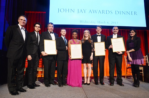 Dean James J. Valentini (far left), along with the John Jay Scholars who presented the honorees with their awards, and the honorees, at the dinner. Left to right, Bryan Terrazas CC '13; Thomas W. Cornacchia CC '85; Ethan Kogan CC '13; Katori Hall '03; Ariana Lott CC '13; Michael J. Schmidtberger CC '82, LW '85; George D. Yancopoulos M.D. Ph.D., CC '80, GSAS '86, P&S '87; and Tehreem Rehman CC '13. PHOTO: EILEEN BARROSO