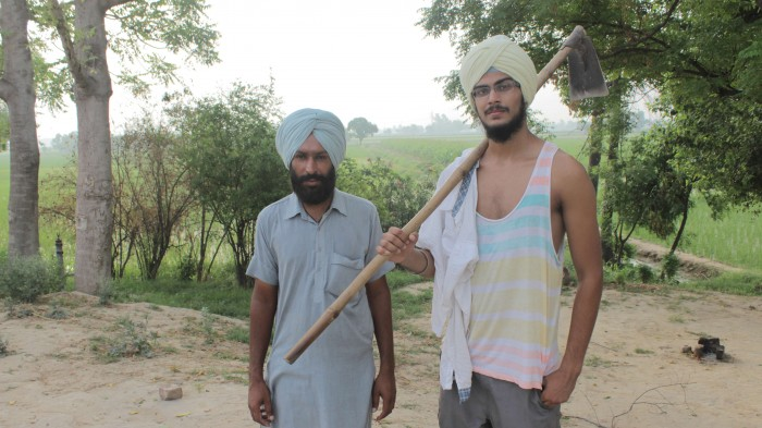 Angad Singh CC '16 (right) and Beant Singh, an organic farmer in the Bathinda province of Punjab. PHOTO: Courtesy of Angad Singh CC '16