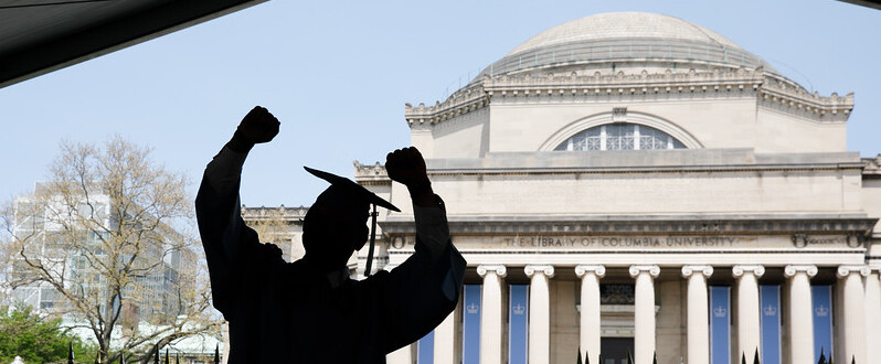 Graduate in Front of Low Library