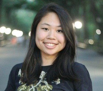 A young Asian woman smiling