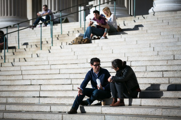 Two People Talking on the Steps