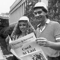 "Photo of students holding Spec's ""Coed At Last"" issue from August 1983"