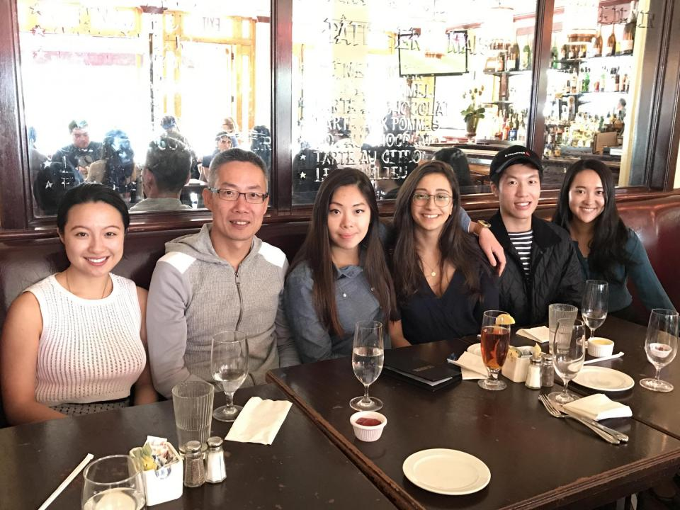 Lee catching up some of with his former interns at Le Monde in 2016.