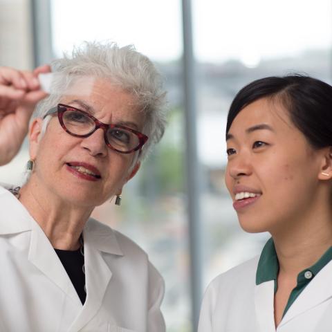 Professor instructing student at Zuckerman Lab