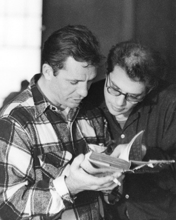 """Beat legends Jack Kerouac '44 (left) and   Allen Ginsberg '48 read a book together in   1959, the year in which author Fred Kaplan   contends """"everything changed."""" photo: john cohen/getty images"""