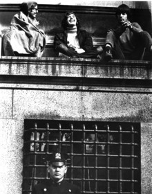 Student rebels perch on a Low Library window ledge as a police officer stands guard below. The police separated the protesting students from counter-protesters during the weeklong standoff. PHOTO: BONNIE FREER