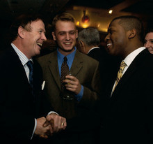 Quigley with students at a College function in 2006. Photo: Eileen Barroso