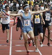 Liam Boylan-Pett '08 crosses the finish line at the Penn Relays.