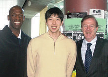Men's basketball coach Joe Jones (left) and player K.J. Matsui '09 with Quigley in Lerner Hall. PHOTO: CHAR SMULLYAN