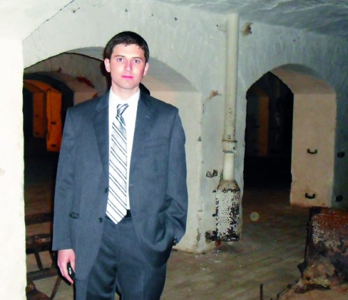 Josh Lipsky '08 in the tunnels under the Buchenwald concentration camp, where the kitchen in which his grandfather worked would have been. Photo: Courtesy of Josh Lipsky '08