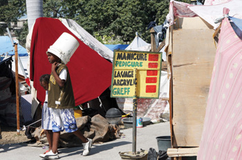 Haitians living in one of the Red Cross' tent cities in downtown Port-au-Prince find ways to set up their own businesses that they run in exchange for food and water.
