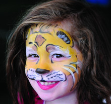 Face-painting was a popular attraction at the pre-game carnival.Photo: Eileen Barroso