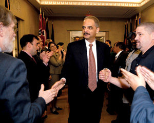 Holder was warmly greeted by Justice Department staff members as he arrived for his first day of work. PHOTO: COURTESY OF THE DEPARTMENT OF JUSTICE