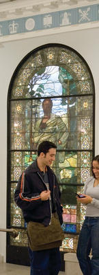 Students in the renovated lobby of Hamilton Hall, with one of the restored Tiffany stained glass windows in the background. Photo: Alan S. Orling