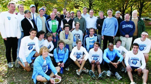 Members of the Ivy League Heptagonal champion 1979 cross-country team join the champion 2009 squad following their victory. Also pictured is former sports information director and athletics historian emeritus Bill Steinman (back row, right). Photos: Gene Boyars, Columbia Athletics