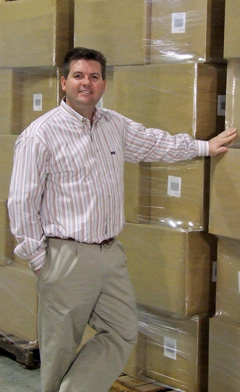 """Steve Heroux '91 at the Hampton Direct warehouse, home of the """"As Seen on TV"""" line of products. PHOTO: TOD GUNTER"""