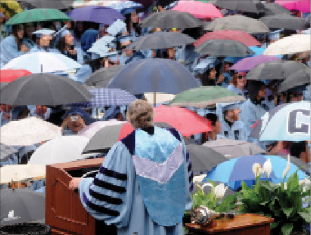 Rain dampened those in attendance at Commencement but not their spirits. President Lee C. Bollinger invoked his executive privilege to cut short the ceremony, including his remarks.