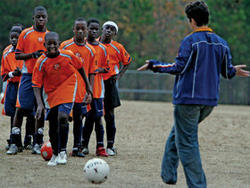 Jeremiah Ziaty is next to take the ball at a Fugees practice. PHOTO: Nicole Bengiveno/The New York Times/Redux