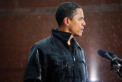 This is Obama at his strongest and most defiant. He, along with thousands of supporters, endured a frigid downpour in Chester, Pa., on the same day that his rival John McCain canceled his event in Pennsylvania due to 'inclement weather.'   It is a photo that almost wasn't made, as both New York Times photographers covering the event that day missed the campaign motorcade, got lost in traffic and almost missed the event.