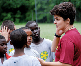 Mufleh talks with members of the under-12 team at practice. PHOTO: COURTESY OF THE FUGEES FAMILY