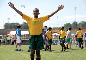 A Fugees player is all smiles after a tournament win in Roswell, Ga. PHOTO: COURTESY OF THE FUGEES FAMILY