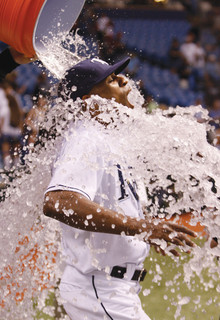 Perez is doused by a teammate after scoring the winning run during a regular-season game after his call-up in September. Photo: Tampa Bay Rays – Skip Milos