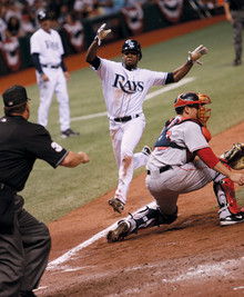 Above, Perez slides home with the winning run after tagging up on a short pop fly to right field as the Rays beat the Boston Red Sox 9–8 in 11 innings in Game 2 of the 2008 American League Championship Series. Photo: Tampa Bay Rays – Steven Kovich