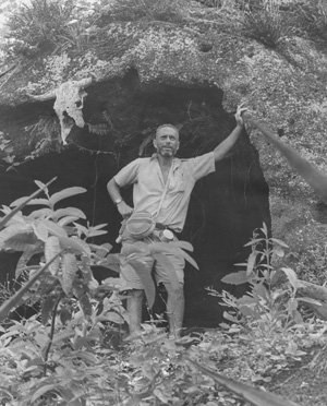 Perlman stands at the entrance to a cave at a remote salt lagoon on   Floreana Island, Galapagos, during a two-month expedition in 1964. Photo: Roger Tory Peterson