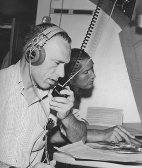 Perlman files a story by radio from the NASA observatory Galileo I, over the Pacific at 39,000 feet, during a 1965 solar eclipse expedition. Photo: Courtesy  David Perlman '39