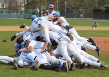 The Lions pile on in celebration after winning the Ivy League championship at Dartmouth with a 7-5 victory in the deciding game of their best-of-3 series on May 7. PHOTO: GIL TALBOT