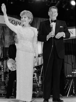 President Ronald Reagan smiles as first lady Nancy Reagan waves to guests at the Ball for Young Americans at the D.C. Armory in Washington, D.C., on January 21, 1985. President Reagan re-enacted his oath of office earlier in the day in the rotunda of the Capitol. PHOTO: AP PHOTO/IRA SCHWARZ