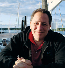 David Rothkopf '77 relaxing in Boothbay Harbor, Maine, where he worked on Superclass last summer. PHOTO: Adrean Rothkopf