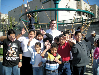 Garcetti surrounded by children at the 2007 opening of Seily Rodriguez Park, the 20th park created in his district since he took office. Photo: Courtesy Eric Garcetti '92, '93 SIPA