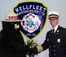 Fire Chief Dan Silverman '70 meets Smokey Bear. PHOTO: Courtesy of Dan Silverman '70