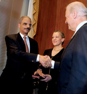 Holder shakes hands with Vice President Joe Biden on February 3 after being sworn in as attorney general. PHOTO: COURTESY OF THE DEPARTMENT OF JUSTICE
