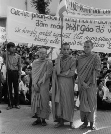 Buddhist monks hold signs protesting the religious policies of President Diem on August 18, 1963, in memorial services at Xa Loi Pagoda for Buddhists who committed suicide by burning as a demonstration against the government. Photo: © Bettmann/CORBIS