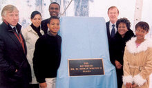 President Lee C. Bollinger and Quigley joined the family of the late Rev. Dr. M. Moran Weston II '30, the University's first African-American trustee, in 2003 for the dedication of Weston Plaza. PHOTO: EILEEN BARROSO