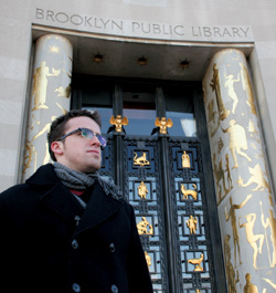 Nick Kelly '09 finds much to read in the main branch of the Brooklyn Public Library. PHOTO: Nora Schaffer '09 Barnard