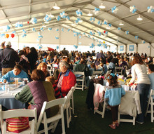 Everyone flocks to the gourmet picnic under the Big Tent to eat, meet and mingle.