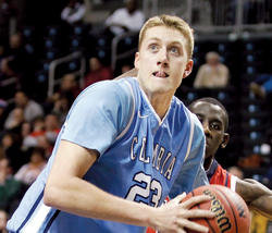 Cory Osetkowski '15 is the hub of Columbia's half-court offense, a center with excellent passing skills and court vision. PHOTO: COURTESY COLUMBIA ATHLETICS