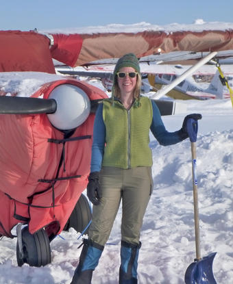 Jessica Cherry '00, GSAS'07 takes a break after digging out her plane from a snowstorm in March 2012. PHOTO: BOB BUSEY