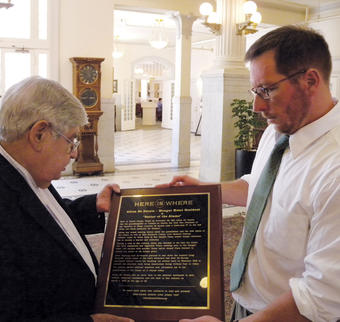 Andrew Carroll '93 (right) installed a plaque at the Menger Hotel in San Antonio last fall; here, with hotel historian Ernesto Malacara.