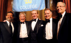 Trustees (left to right) Richard E. Witten '75; Bill Campbell '62, '64 TC; Mark E. Kingdon '71; and Philip Milstein '71 honored their fellow trustee, Rothfeld.