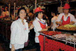 During her internship in Hong Kong last summer, Amy Huang '11 traveled to Beijing, where she sampled the  local cuisine, including fried silkworms.