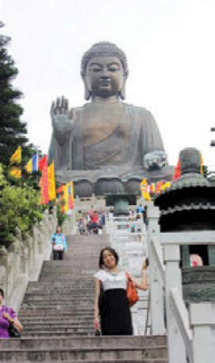 Amy Huang '11 takes a break from work to visit the Tian Tan Buddha in Hong Kong.