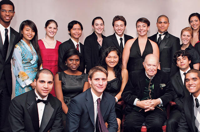 Kluge posed at the 2008 Alexander  Hamilton Award Dinner with some who have benefited from his generosity. PHOTO: CHAR SMULLYAN