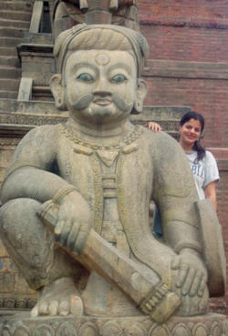 Tina Wadhwa '07 poses  next to a statue in front of  a temple in Rajastan. Photo: Noelle Fritz